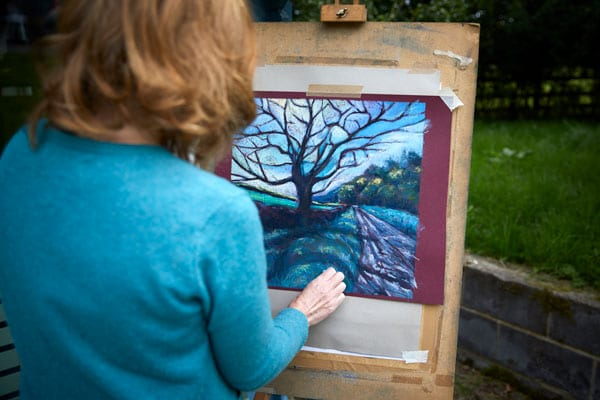 One of our associate artists at her easel
