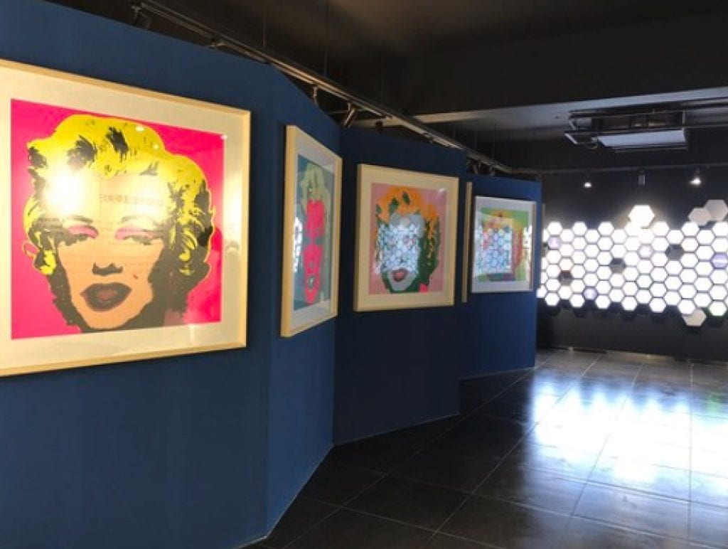 RS Weinblatt's work, featured in Chinese Gallery, alongside work by Andy Warhol.
