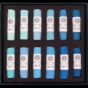 The Ocean Blue set of 12 pastels ranging from aqua turquoise to deep blue.