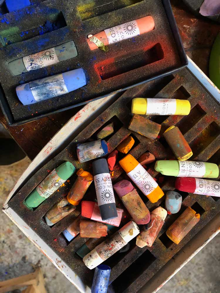 An open box of well used pastels.