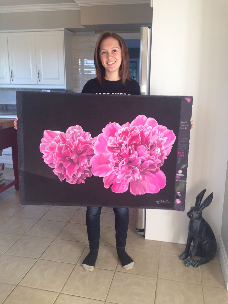 Profile photo of Maya Venters, with painting.