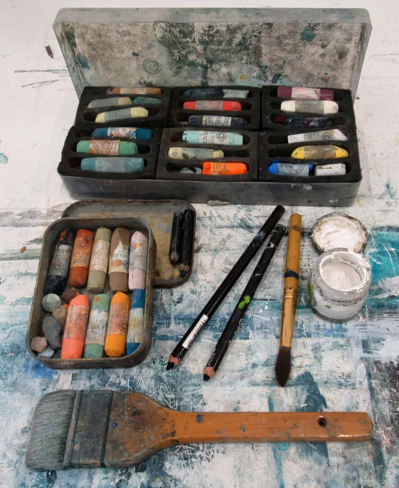 Pastels and brushes.