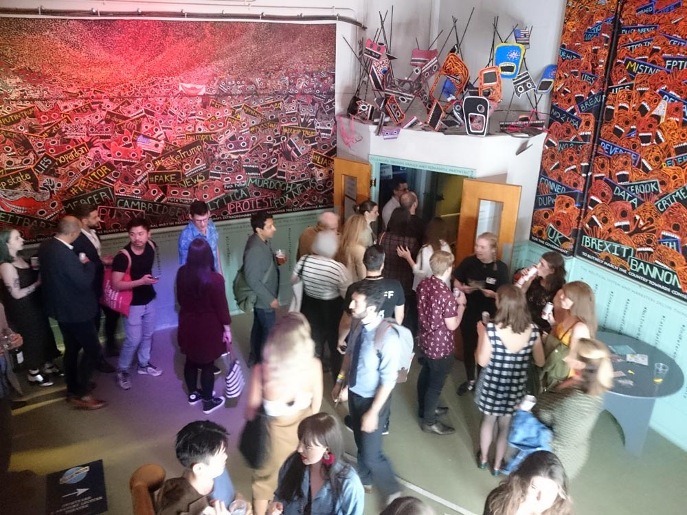 People fill the venue.