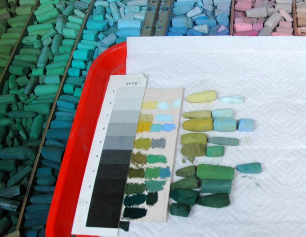 Selection of pastels with grey scale and colour swatches.