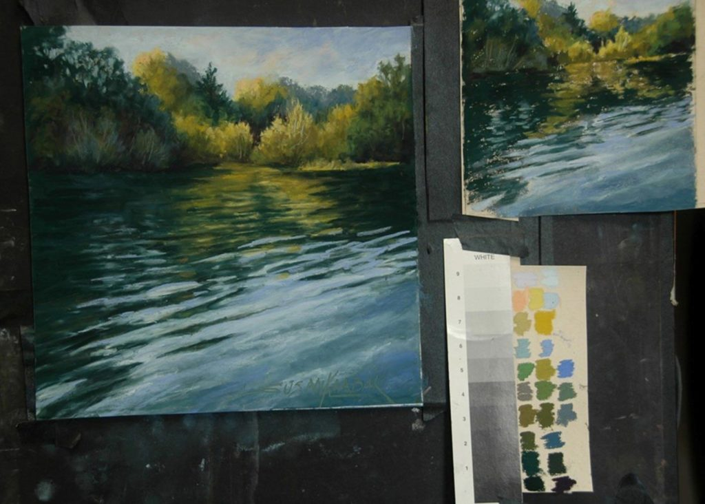 The finished painting on the easel with the colour study and colour swatch.