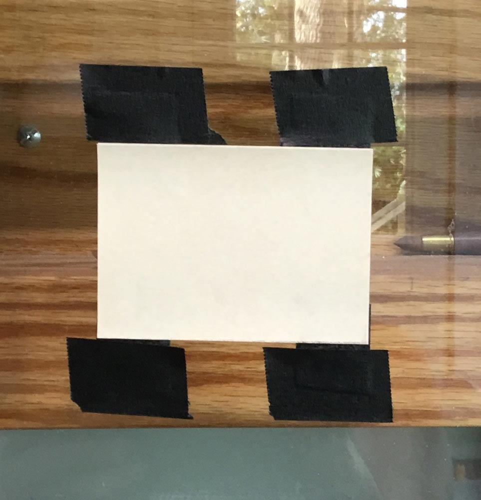 ATCs taped to the plexiglass.