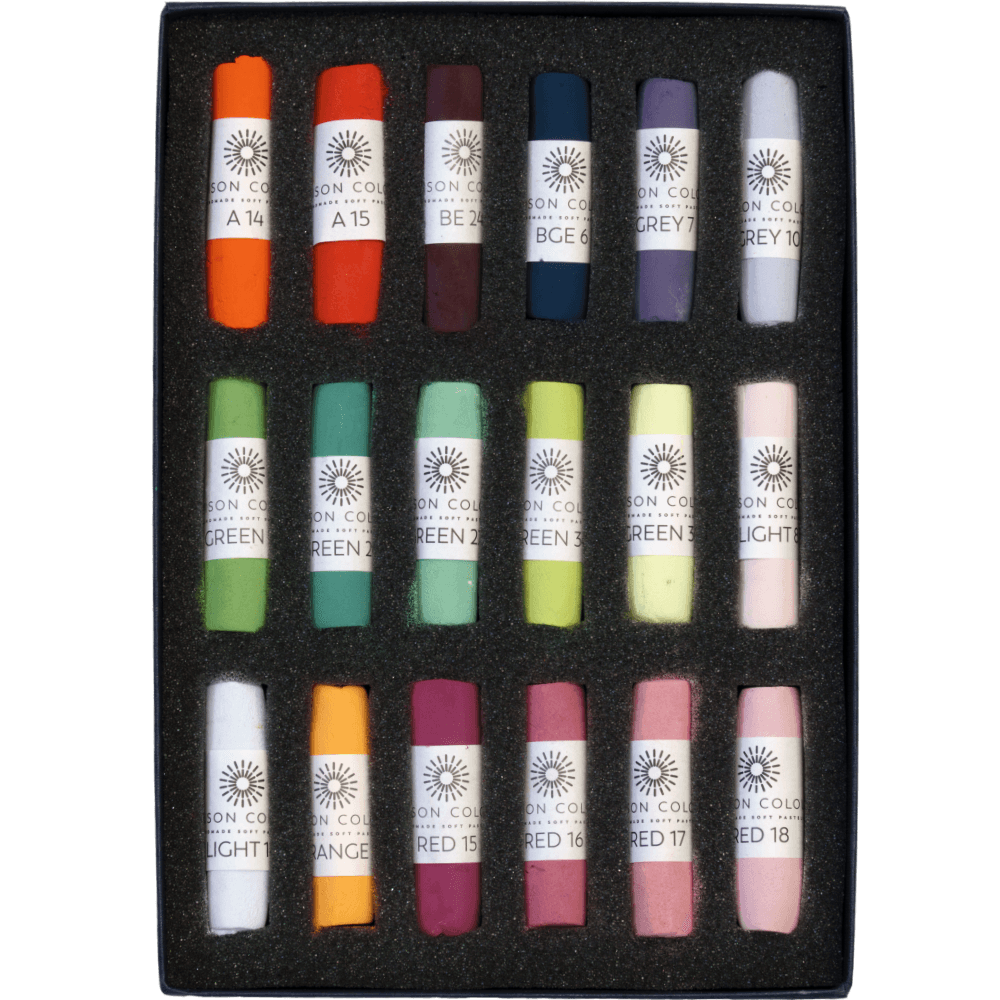Open box of pastels, displaying the contents inside.