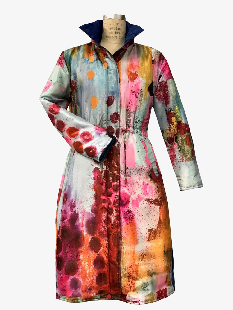 Ubuclothing raincoat using fabric printed with Judy's Solitaire painting.
