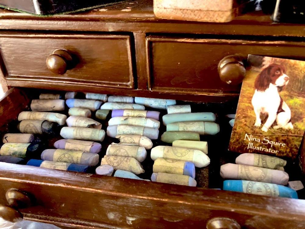 Nina's chest of wooden drawers in which she stores her Unison Colour pastels.